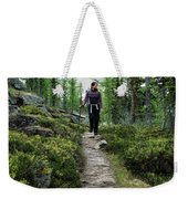A Young Woman Walks Along An Sub-alpine Weekender Tote Bag