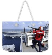 Airman Fires A Shot Line From Uss Weekender Tote Bag