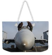 Airmen Clean The Canopy Of An Fa-18f Weekender Tote Bag by Stocktrek Images