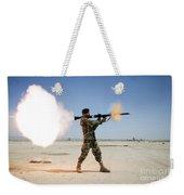 An Afghan National Army Soldier Fires Weekender Tote Bag by Stocktrek Images
