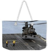 An Army Mh-47g Chinook Conducts Deck Weekender Tote Bag