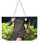 An Athletic Woman Trail Running Weekender Tote Bag
