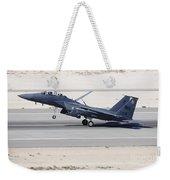 An F-15c Eagle Landing On The Runway Weekender Tote Bag