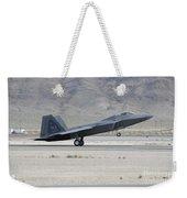 An F-22 Raptor Landing On The Runway Weekender Tote Bag