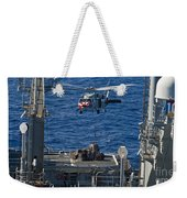 An Mh-60s Sea Hawk Delivers Supplies Weekender Tote Bag