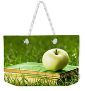 Apple On Pile Of Books On Grass Weekender Tote Bag