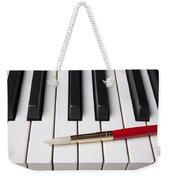 Artist Brush On Piano Keys Weekender Tote Bag