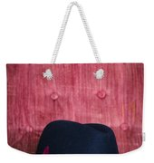 Black Hat On Red Velvet Chair Weekender Tote Bag by Edward Fielding