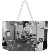 Boy Making A Pyramid Of Cards Weekender Tote Bag by Underwood Archives