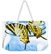 Butterfly On A Blue Jar Weekender Tote Bag by Bob Orsillo