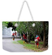 Camouflaged Leaf Blowers Working In Singapore Park Weekender Tote Bag