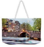 Canal Bridge And Boat Tour In Amsterdam At Evening Weekender Tote Bag