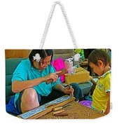 Child Watches As Mom Works In Teak Wood Carving Shop In Kanchanaburi-thailand Weekender Tote Bag