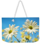 Close-up Of Daisies Against A Blue Weekender Tote Bag