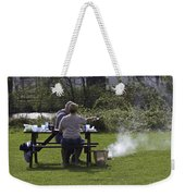 Couple Enjoying A Picnic In A Grassy Area Weekender Tote Bag