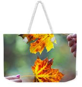 Couple Holding Autumn Leaves Weekender Tote Bag
