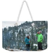 Couple Standing By A Campfire Weekender Tote Bag
