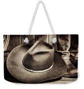 Cowboy Hat On Floor Weekender Tote Bag by Olivier Le Queinec