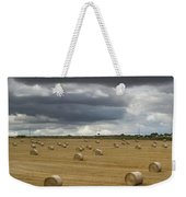 Dark Storm Clouds Over A Field With Hay Weekender Tote Bag