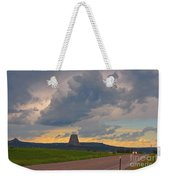Devils Tower On The Horizon At Sunset Weekender Tote Bag