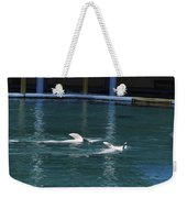 Dolphins Swimming Upside Down As Part Of Show Weekender Tote Bag