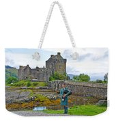 Eilean Donan Castle And The Lone Piper Weekender Tote Bag