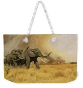 Elephants Moving Before A Fire Weekender Tote Bag