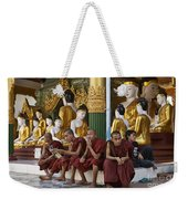faithful Buddhist monks siiting around Buddha Statues in SHWEDAGON PAGODA Weekender Tote Bag