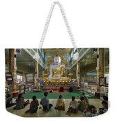 faithful Buddhists praying at sitting Buddha in golden Ponnya Shin Pagoda Weekender Tote Bag