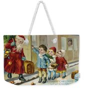 Father Christmas Disembarking Train Weekender Tote Bag by Mary Evans