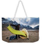 Female Hiker Sets Up Tent On Wild Weekender Tote Bag