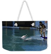 Female Trainer Feeding 2 Dolphins At The Underwater World In Sentosa Weekender Tote Bag