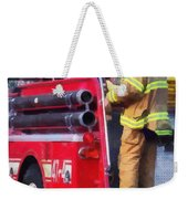 Fireman On Back Of Fire Truck Weekender Tote Bag