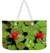 Floating Red Water Lilly Flowers On Pond Weekender Tote Bag