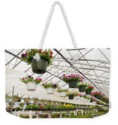 Flowers Growing In Foil Hothouse Of Garden Center Weekender Tote Bag