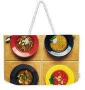 Four Dishes Of Different Food Weekender Tote Bag