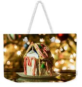 Gingerbread House Against A Background Of Christmas Tree Lights Weekender Tote Bag