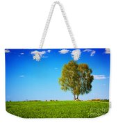 Green Field Landscape With A Single Tree Weekender Tote Bag