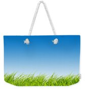 Green Fresh Grass On Blue Sky Panorama. Weekender Tote Bag