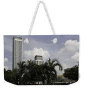 High Rise Buildings Behind Trees Along With Construction Work In Singapore Weekender Tote Bag