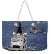 Hms Cornwall Is Pictured Receiving Stores By Merlin Helicopter  Weekender Tote Bag