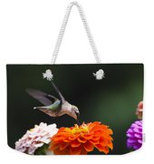 Hummingbird In Flight With Orange Zinnia Flower Weekender Tote Bag by Christina Rollo