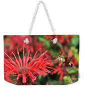Hummingbird Moth Feeding On Red Flower Weekender Tote Bag