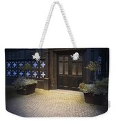 Illuminated Lamp Above The Doorway Of A Timber Framed Tudor Buil Weekender Tote Bag