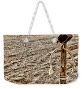 Lasso And Hat On Fence Post Weekender Tote Bag by Olivier Le Queinec
