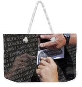 Man Getting A Rubbing Of Fallen Soldier's Name At The Vietnam War Memorial Weekender Tote Bag