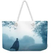 Man In Top Hat And Cape On Foggy Dirt Road Weekender Tote Bag