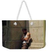 Man Leaning Against Wall In Sun Weekender Tote Bag