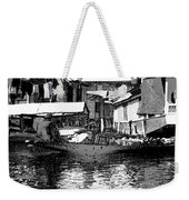 Man Plying A Small Boat Laden With Vegetables In The Dal Lake Weekender Tote Bag