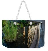 New York Skyscrapers Reflecting In A Beautiful Little Fountain With Flowers Weekender Tote Bag